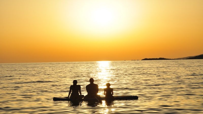Family enjoying Sunset SUP hire from AQUA SUPS